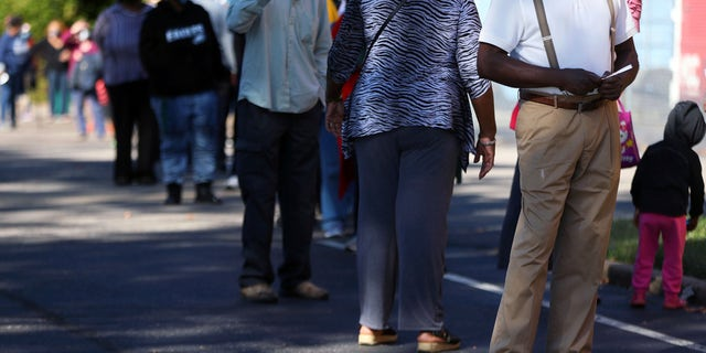 Voters wait on line at the Pursuit of God Church, Wednesday, Oct. 14, 2020, in Memphis, Tenn., on the first day of Tennessee's early voting. (Patrick Lantrip/Daily Memphian via AP)