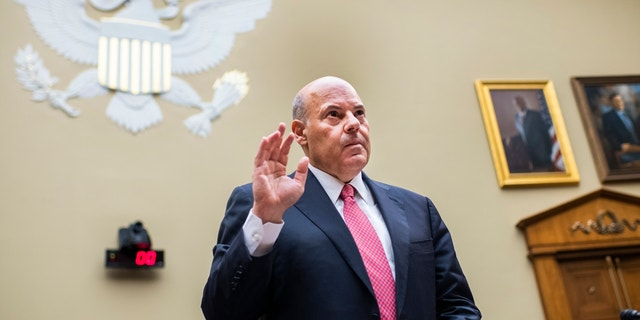 Postmaster General Louis DeJoy is sworn in before testifying during a House Oversight and Reform Committee hearing on Capitol Hill on Aug. 24. (Tom Williams/Pool Photo via AP, File)