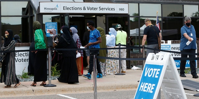 Minneapolis voters line up to vote a day ahead of Minnesota's Tuesday primary election at the Minneapolis Election and Voters Services offices. (AP Photo/Jim Mone, File)