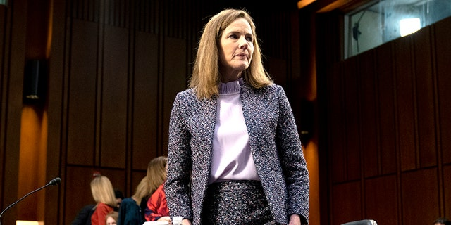 Supreme Court nominee Amy Coney Barrett departs during a break in a confirmation hearing before the Senate Judiciary Committee on Capitol Hill in Washington. (Stefani Reynolds/Pool via AP)
