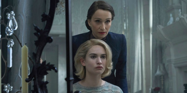 Kristin Scott Thomas, background, and Lily James in a scene from 'Rebecca.'