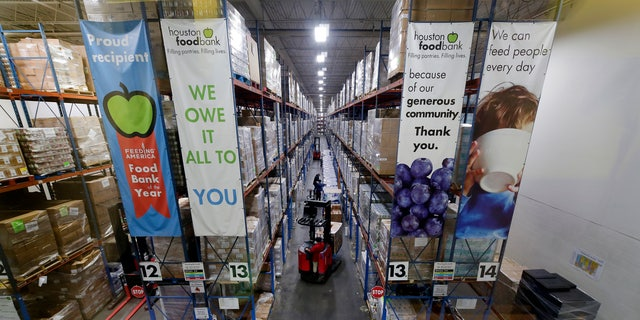 Pallets of various foods are stacked on shelves in the warehouse at the Houston Food Bank on Oct. 14. (AP Photo/Michael Wyke)