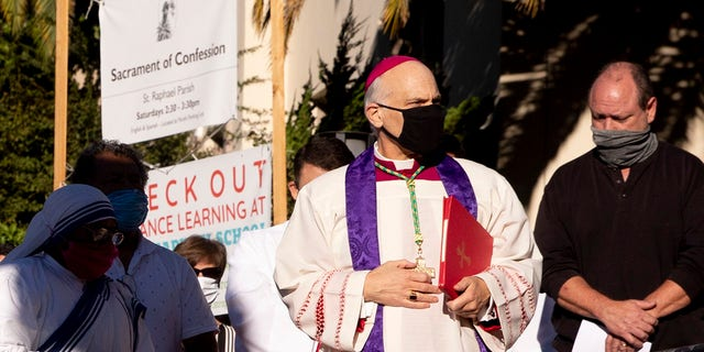 San Francisco's Archbishop Salvatore Cordileone conducts an exorcism Saturday, Oct. 17, 2020, outside Saint Raphael Catholic Church in San Rafael, Calif., on the spot where a statue of St. Junipero Serra was toppled during a protest on Oct. 12. (Associated Press)