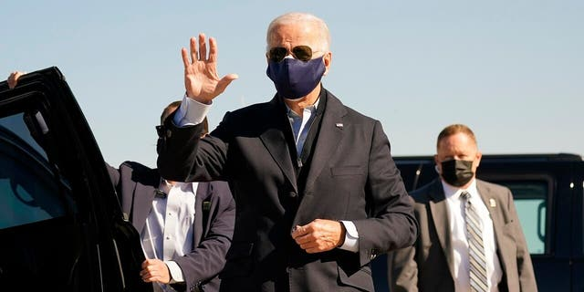 Democratic presidential candidate former Vice President Joe Biden arrives to board his campaign plane at the New Castle Airport in New Castle, Del., Sunday, Oct. 18, 2020, en route to Durham, N.C. (Associated Press)