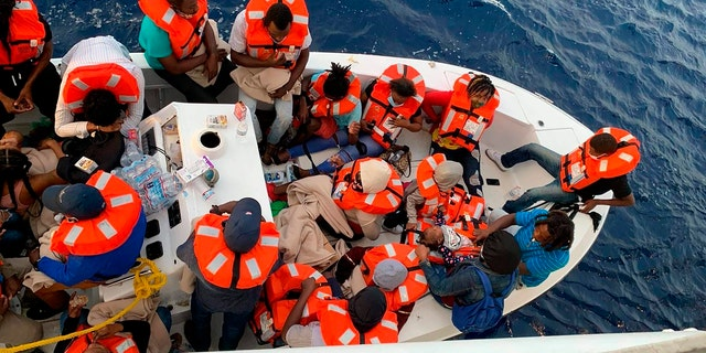 This photo provided by Carnival Cruise Line shows people after being rescued by a Carnival Cruise Line ship off the Florida coast, the cruise line reported Saturday, Oct. 17, 2020. (Carnival Cruise Line via AP)