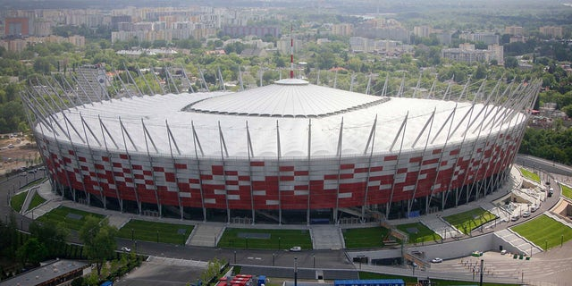 This Friday, May 18, 2012 file photo aerial view, made from an hot air balloon, shows the National Stadium, in Warsaw, Poland. Poland's government is transforming the National Stadium in Warsaw into a field hospital to handle the surging number of patients infecting with the coronavirus. (AP Photo/Czarek Sokolowski, File)