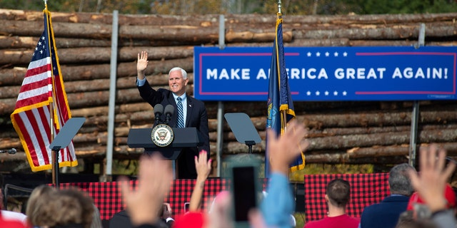 Vice President Mike Pence waves to supporters at a campaign rally, Monday, Oct. 19, 2020, at Dysarts in Hermon, Maine. (Linda Coan O'Kresik/The Bangor Daily News via AP)