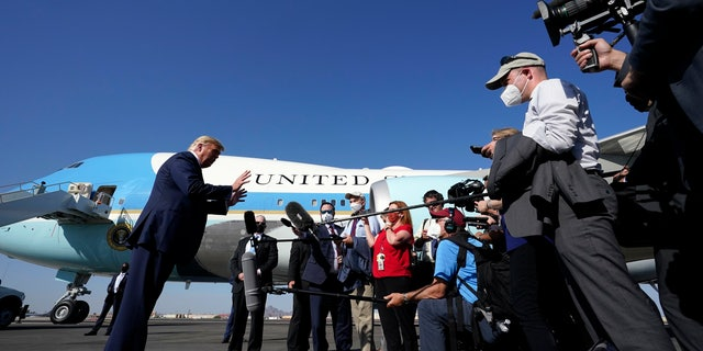 President Trump speaks to reporters at Phoenix Sky Harbor International Airport, Monday, Oct. 19, 2020, in Phoenix. (AP Photo/Alex Brandon)