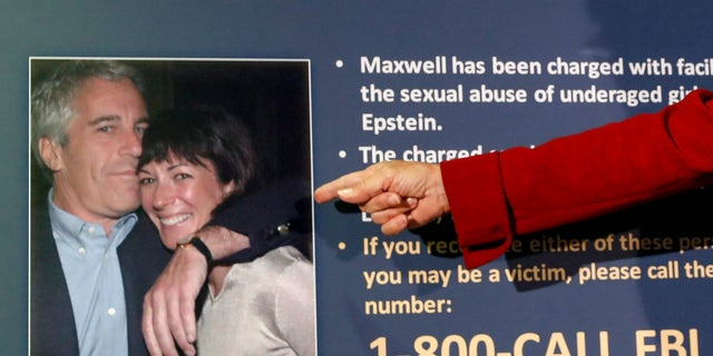 FILE - In this July 2, 2020, file photo, Audrey Strauss, acting United States Attorney for the Southern District of New York, points to a photo of Jeffrey Epstein and Ghislaine Maxwell during a news conference, in New York. (AP Photo/John Minchillo, File)