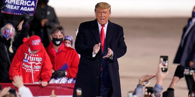 President Donald Trump arrives for a campaign rally at Erie International Airport, Tom Ridge Field in Erie, Pa, Tuesday, Oct. 20, 2020. (AP Photo/Gene J. Puskar)