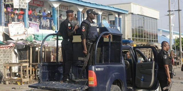 Police officers patrol near the Lekki toll gate in Lagos, Nigeria, Wednesday Oct. 21, 2020. ( AP Photo/Sunday Alamba)