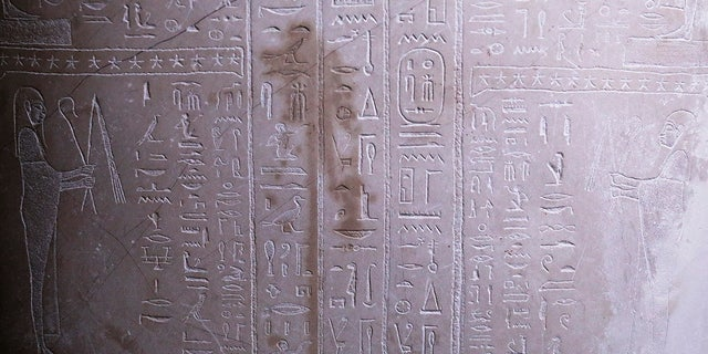 A stain is on Sarcophagus of the prophet Ahmose inside the Egyptian Court of the Neue Museum after smeared with a liquid in Berlin, Wednesday, Oct. 21, 2020. (AP Photo/Markus Schreiber)