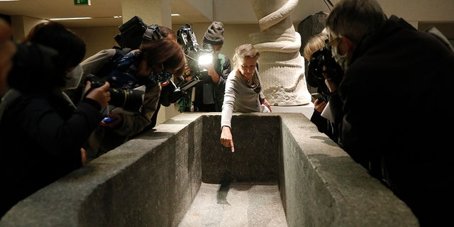 Frédéric Seifried, director of the Department of Antique Egypt, shows the media a stain from the liquid inside the Sarcofurg of Hell Museum on Wednesday, Wednesday, October 21, 2020, in Berlin.  (AP Photo / Marcus Greiber)