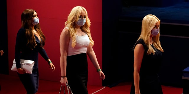 Kimberly Guilfoyle, Tiffany Trump and White House adviser Ivanka Trump arrive for the second and final presidential debate Thursday, Oct. 22, 2020, at Belmont University in Nashville, Tenn. (AP Photo/Patrick Semansky)