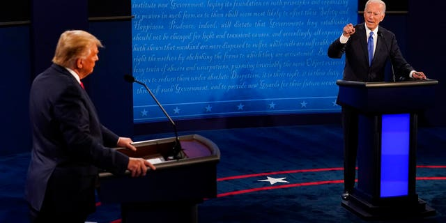Democratic presidential candidate former Vice President Joe Biden points toward President Trump during the second and final presidential debate Thursday, Oct. 22, 2020, at Belmont University in Nashville, Tenn. (AP Photo/Morry Gash, Pool)