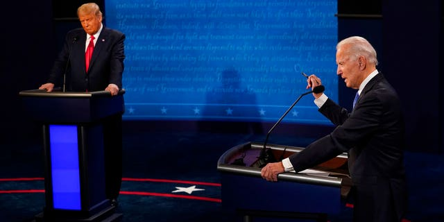 Democratic presidential candidate former Vice President Joe Biden answers a question and President Trump listens during the second and final presidential debate Thursday, Oct. 22, 2020, at Belmont University in Nashville, Tenn. (AP Photo/Morry Gash, Pool)