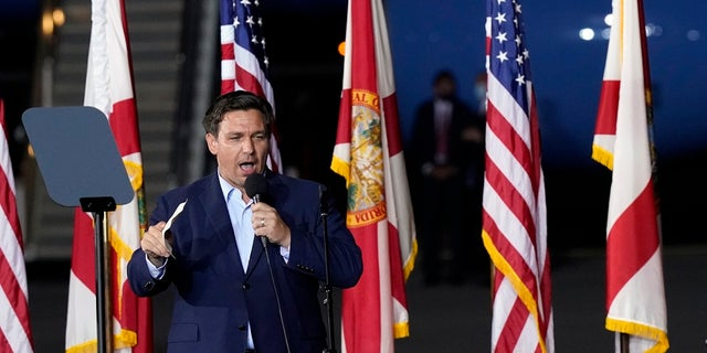 Florida Gov. Ron DeSantis speaks before President Donald Trump at a campaign rally in Pensacola, Fla., last week. His address was illegally changed and found out Monday when he tried to cast a ballot. (AP Photo/Gerald Herbert)