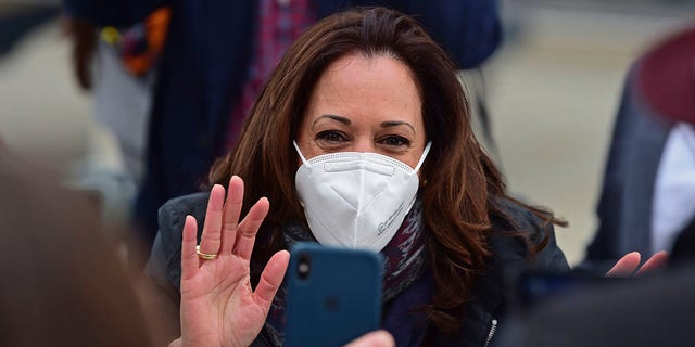 Democratic vice presidential candidate Sen. Kamala Harris, D-Calif., waves to a cell phone during a campaign event, Saturday, Oct. 24, 2020, in Cleveland. (Associated Press)