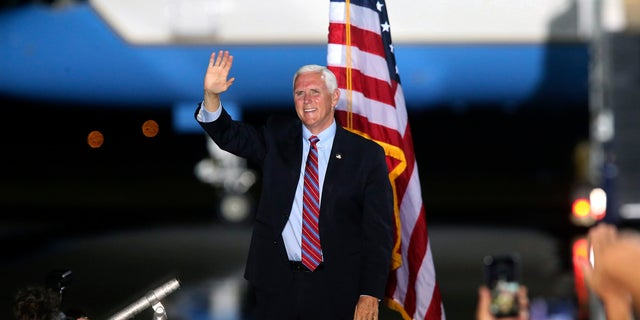 Pence waves to supporters Saturday Oct. 24, 2020 in Tallahassee, Fla. (AP Photo/Steve Cannon)