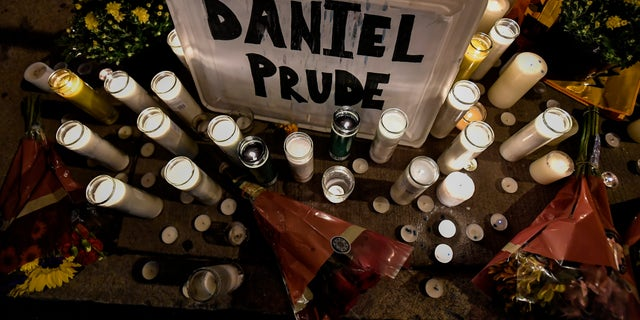 In this Sept. 2, 2020, file photo, candles light a makeshift memorial for Daniel Prude, a Black man who died while restrained and in police custody in Rochester, N.Y., in March.  (AP Photo/Adrian Kraus, File)