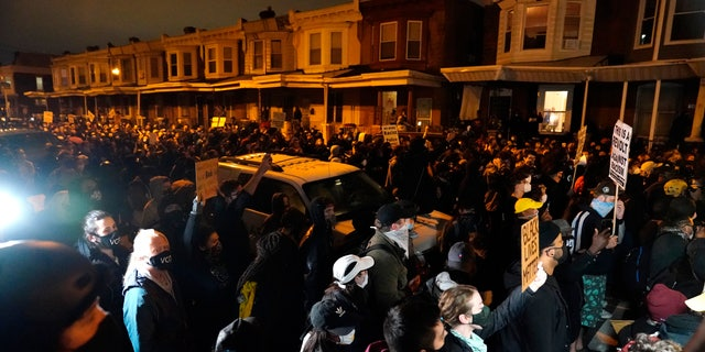 Protesters confront police during a march Oct. 27, in Philadelphia.  (AP Photo/Matt Slocum)