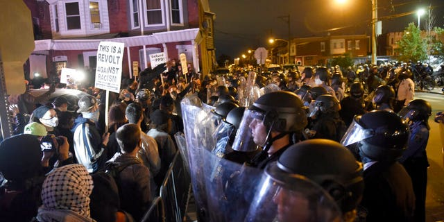 Protesters face off with police during a demonstration Tuesday, Ott. 27, 2020, a Philadelphia.