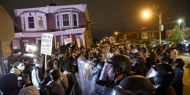 Protesters face off with police during a demonstration Tuesday in Philadelphia