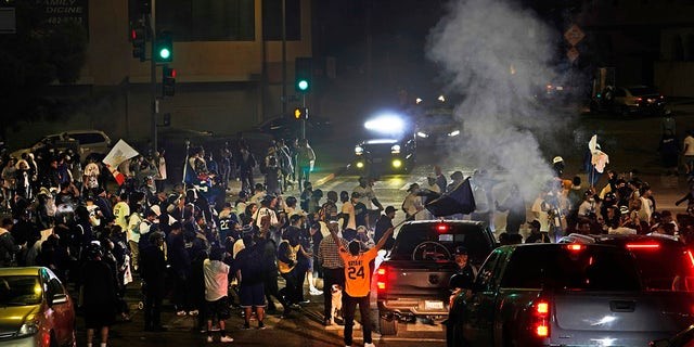 Los Angeles Dodgers fans block traffic on Sunset Boulevard after watching the broadcast of Game 6 of the baseball World Series in Los Angeles on Tuesday, Oct. 27, 2020. The Los Angeles Dodgers defeated the Tampa Bay Rays 3-1 and won the World Series. (AP Photo/Damian Dovarganes)