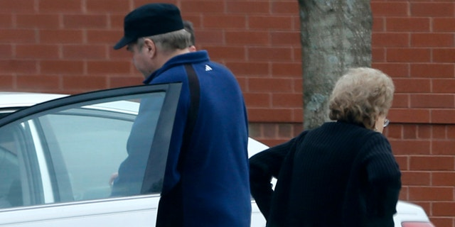 In this photo taken March 19, 2015, John Hinckley gets into his mother's car in front of a recreation center in Williamsburg, Va. (AP Photo/ Steve Helber)