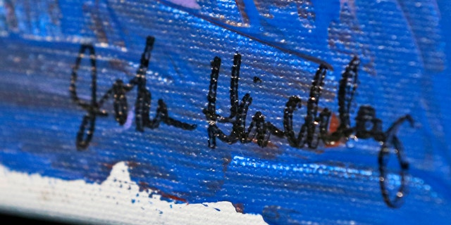 In this photo taken March 18, 2015, the signature on a painting by John Hinkley is seen in Hampton, Va. (AP Photo/Steve Helber)