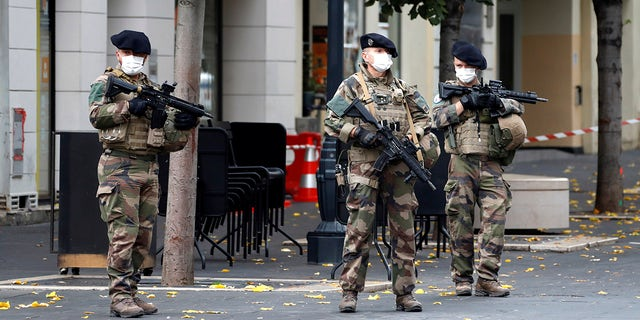 Soldiers patrol near Notre Dame church in Nice, southern France, on Thursday after an attacker armed with a knife killed three people at a church.  (Eric Gaillard / Pool via AP)
