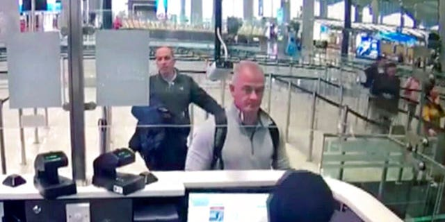 FILE - This Dec. 30, 2019 image from security camera video shows Michael L. Taylor, center, and George-Antoine Zayek at passport control at Istanbul Airport in Turkey. The U.S. State Department had agreed to turn over to Japan Taylor and his son Peter Taylor, who are accused of smuggling former Nissan Motor Co. Chairman Carlos Ghosn out of the country while he was awaiting trial, the men's lawyers said in legal filing on Thursday, Oct. 29, 2020. (DHA via AP)