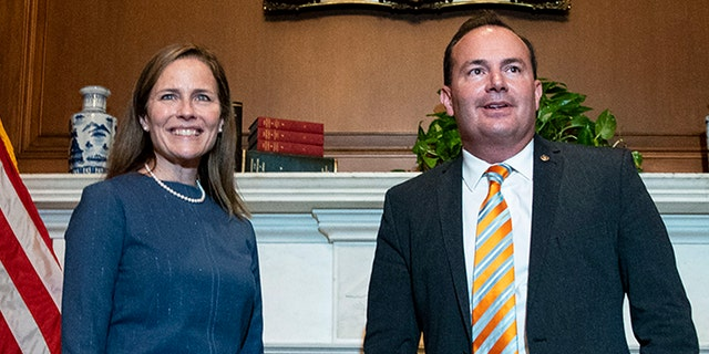 Judge Amy Coney Barrett, President Donald Trump's nominee to the Supreme Court, meets with Sen. Mike Lee, R-Utah, at the Capitol, Tuesday, Sept. 29, 2020 in Washington. (Al Drago/Pool via AP)