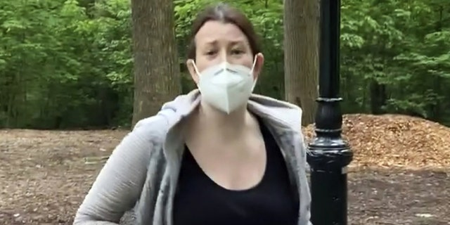 FILE - This file image, made from May 25, 2020, video provided by Christian Cooper, shows Amy Cooper with her dog talking to Christian Cooper in Central Park in New York. Amy Cooper, walking her dog who called the police during a videotaped dispute with Christian Cooper, a Black man, was charged Monday, July 6, 2020, with filing a false report. (Christian Cooper via AP, File)
