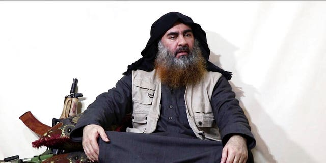 This file image made from video posted on a militant website April 29, 2019, purports to show the leader of the Islamic State group, Abu Bakr al-Baghdadi, being interviewed by his group's Al-Furqan media outlet. (Al-Furqan media via AP)