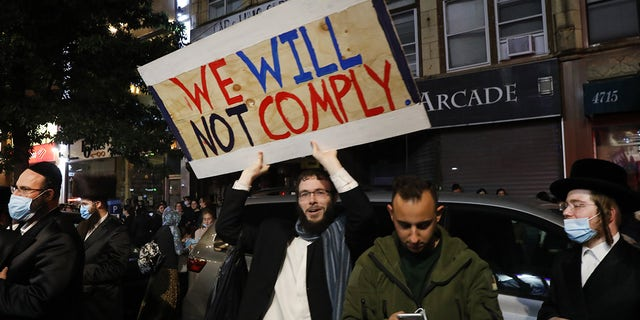 Groups of protesters gather in the Brooklyn neighborhood of Borough Park to denounce lockdowns of their neighborhood due to a spike in COVID-19 cases on Oct. 7, 2020, in New York City. (Spencer Platt/Getty Images)