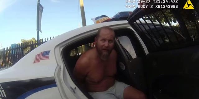 Brad Parscale in the back of a cop car, shortly after his arrest on Sept. 27.