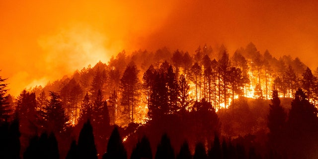 Dry, windy weather posed an extreme wildfire risk Wednesday, Oct. 14, 2020, in Northern California, where massive blazes already have cost hundreds of homes and killed or injured dozens of people.