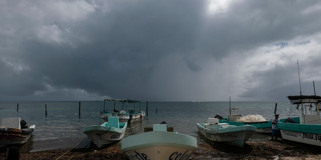 Boats sit closer to the shore after they were secured by fishermen preparing for the arrival of Hurricane Delta in Puerto Juarez, Cancun, Mexico, Tuesday, Oct. 6, 2020.
