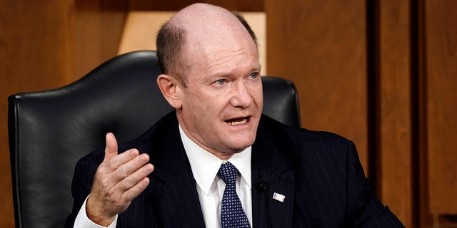 Sen. Chris Coons, D-Del., speaks as the Senate Judiciary Committee hears from legal experts on the final day of the confirmation hearing for Supreme Court nominee Amy Coney Barrett, on Capitol Hill in Washington, Thursday, Oct. 15, 2020. Coons has softened his support for the legislative filibuster in recent years after leading an effort to protect it in 2017. (AP Photo/J. Scott Applewhite)