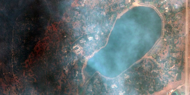 This satellite image provided by Maxar Technologies shows a natural color photo of the Lake of the Pines neighborhood and Allens Lake, Tuesday, Oct. 20, 2020, after the CalWood Fire burned through the area, west of Longmont, Colo., in Boulder County.