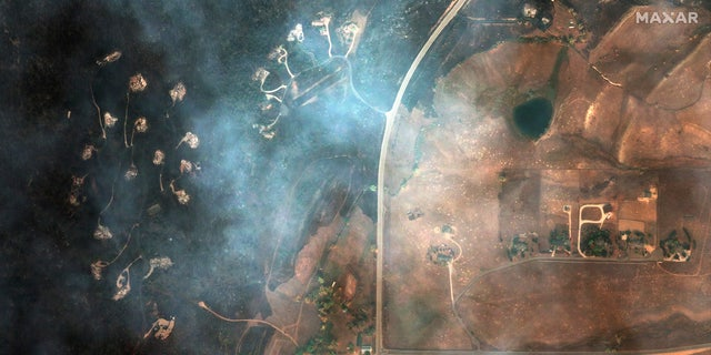 This satellite image provided by Maxar Technologies shows a natural color photo of Mountain Ridge Road and Foothills Ranch Drive, Tuesday, Oct. 20, 2020, after the CalWood Fire burned through the area, west of Longmont, Colo., in Boulder County.