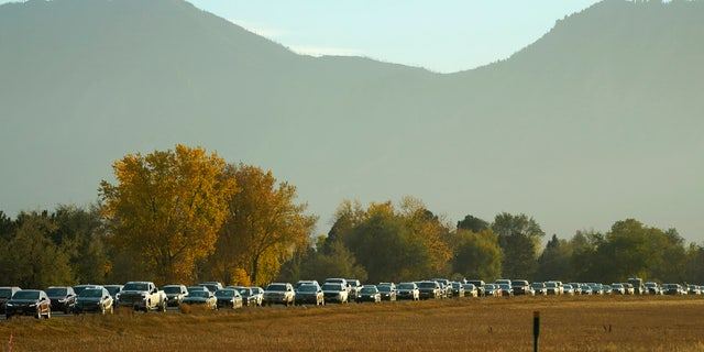 Smoke from several wildfires burning in the state obscures the mountains as traffic backs up on northbound Highway 119 late Wednesday, Oct. 21, 2020, in Boulder, Colo.