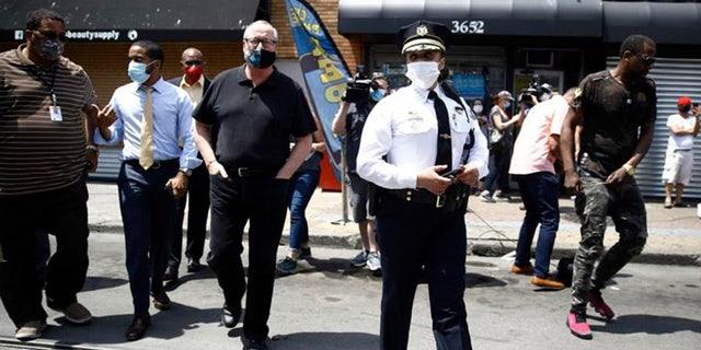 Philadelphia Police Commissioner Danielle Outlaw, center, and Mayor Jim Kenney, 4th left, meet with people, Thursday, June 4, 2020, in Philadelphia. (AP Photo/Matt Rourke)