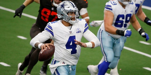 Dallas Cowboys quarterback Dak Prescott (4) scrambles out of the pocket before throwing a pass in the second half of an NFL football game against the Cleveland Browns in Arlington, Texas, Sunday, Oct. 4, 2020. (AP Photo/Michael Ainsworth)