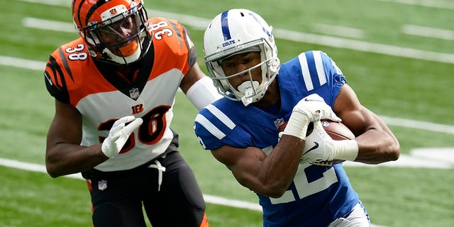 Indianapolis Colts's DeMichael Harris runs against Cincinnati Bengals' LeShaun Sims (38) during the second half of an NFL football game, Sunday, Oct. 18, 2020, in Indianapolis. (AP Photo/Michael Conroy)
