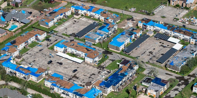 Blue tarps cover houses in the aftermath of Hurricane Delta, Saturday Oct. 10, 2020, in Lake Charles, La.