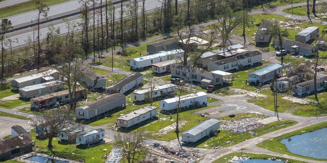 A devastated trailer park is seen in the aftermath of Hurricane Delta, Saturday Oct. 10, 2020, in Iowa, La.