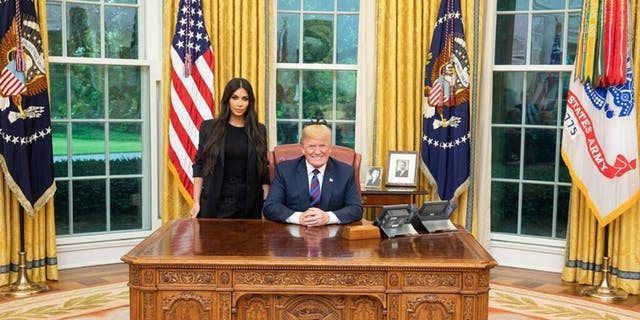 Kim Kardashian said she was warned that working with President Donald Trump could damage her reputation.