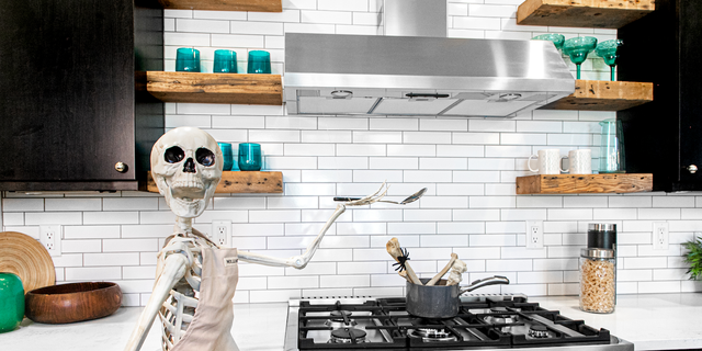 A real estate agent with a funny bone is celebrating the spooky season by decorating homes with skeleton décor.